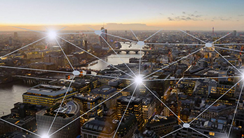 A city, with a graphic of interconnections on top