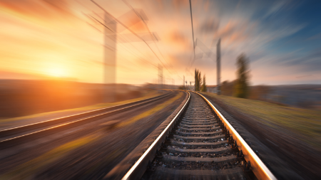 picture of rail line at sunset
